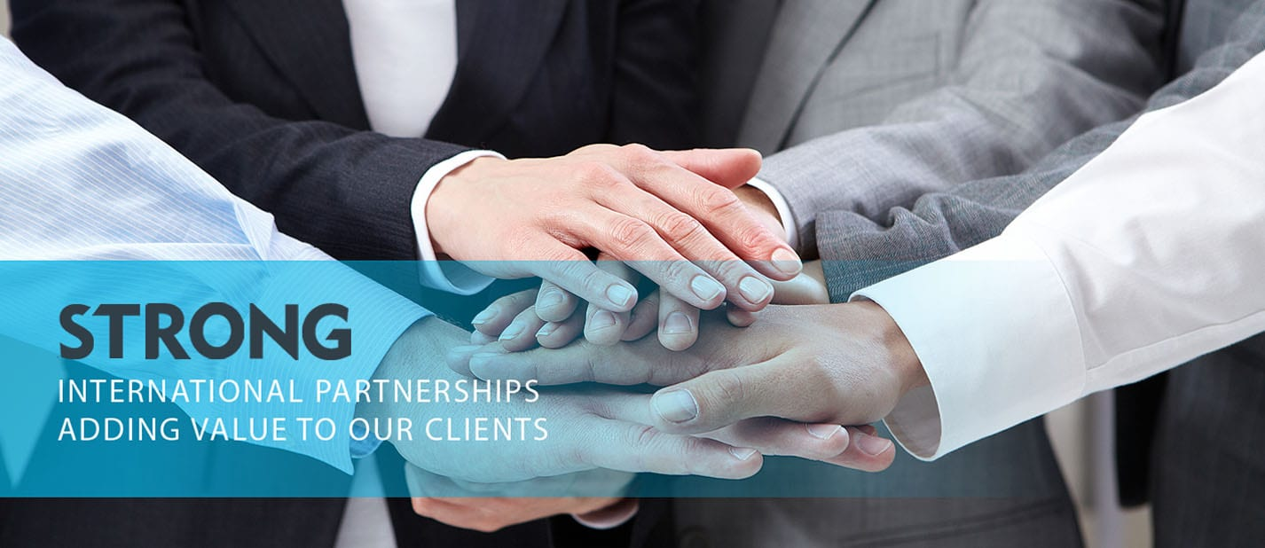 ardmac international partners image showing multiple hand shake