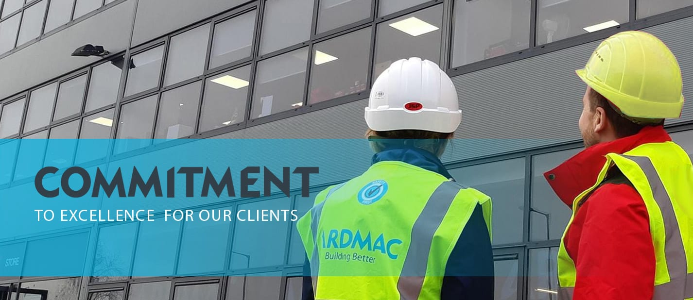 Ardmac - Two construction workers viewing a building